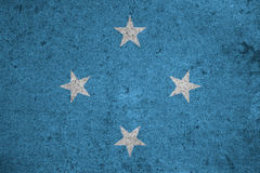 Flag Micronesia. Micronesia flag on an old grunge background Royalty Free Stock Photos