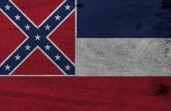 Flag of Mississippi on wooden plate background. Grunge Mississippi flag texture, The states of America. The canton is square, spans two stripes, consists of a royalty free stock images