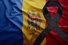 Flag of moldova with black mourning ribbon. Waving national flag of moldova with black mourning ribbon Stock Image