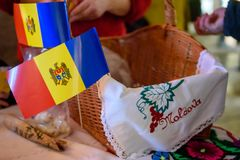 Flag of Moldova at Christmas Charity Bazaar, organised by The International Women`s Club of Riga. 01.12.2018. RIGA, LATVIA. Christmas Charity Bazaar, organised royalty free stock photo