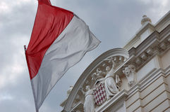 Flag of Monaco. Flag of Monaco in front of the Palace of Monaco Royalty Free Stock Photography