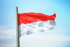 Flag of Monaco. Against the background of the sky Stock Photography