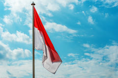 Flag of Monaco. Flag of of Monaco in the background of sky Stock Photography