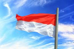 Flag of Monaco. Against the background of the sky Royalty Free Stock Photo