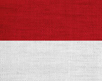 Flag of Monaco on old linen Royalty Free Stock Images