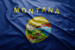 Flag of Montana state. Waving colorful Montana state flag Royalty Free Stock Images