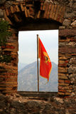 Flag of Montenegro. Details of the ancient city wall of Kotor. The flag of Montenegro Royalty Free Stock Photos
