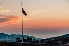 Flag of Montenegro on the background of the sunset. stock images