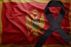 Flag of montenegro with black mourning ribbon. Waving national flag of montenegro with black mourning ribbon Royalty Free Stock Photos