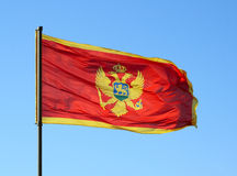 Flag of Montenegro on a blue sky Stock Images