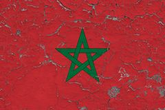 Flag of Morocco painted on cracked dirty wall. National pattern on vintage style surface vector illustration