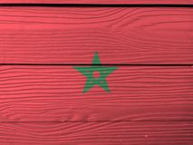Flag of Morocco on wooden wall background. Grunge Moroccan flag texture. stock images