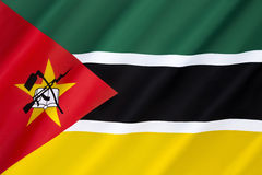 Flag of Mozambique. Adopted on 1 May 1983. It includes the image of an AK-47 with a bayonet attached to the barrel and is the only national flag in the world Royalty Free Stock Images
