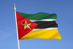 Flag of Mozambique - Africa. The flag of Mozambique was adopted on 1 May 1983. It includes the image of an AK-47 with a bayonet attached to the barrel and is the Royalty Free Stock Images