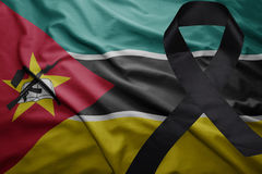 Flag of mozambique with black mourning ribbon Stock Photos