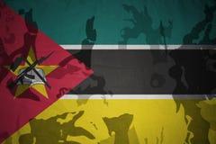Flag of mozambique on the khaki texture . military concept Stock Photo