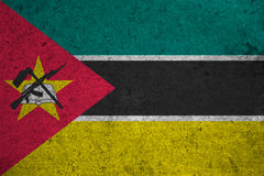 Flag Mozambique. Mozambique flag on an old grunge background Stock Photo