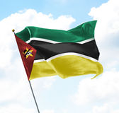 Flag of Mozambique. Raised Up in The Sky Royalty Free Stock Photo