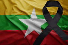 Flag of myanmar with black mourning ribbon. Waving national flag of myanmar with black mourning ribbon Stock Photography