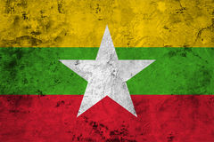 Flag of the Myanmar Burma close up. Flag of the Myanmar Burma against the background of the stone texture Royalty Free Stock Photos