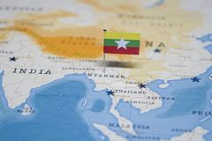 The Flag of myanmar in the world map.  royalty free stock image
