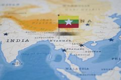The Flag of myanmar in the world map.  royalty free stock photo