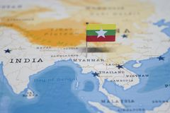 The Flag of myanmar in the world map.  stock images