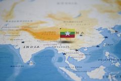 The Flag of myanmar in the world map.  stock photography