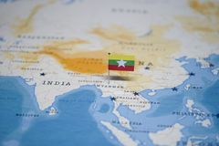The Flag of myanmar in the world map.  stock photo