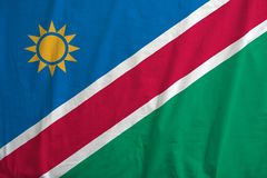 Flag Of Namibia waving. Fabric texture of the flag of Namibia Royalty Free Stock Photography