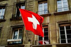 Flag. National flag of Switzerland against windows of the old house in Bern Stock Photography