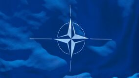 The flag of NATO flutters in the wind