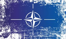 Flag of NATO, North Atlantic Treaty Organization. Wrinkled dirty spots. stock images