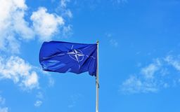 Flag of NATO waving in wind Royalty Free Stock Photos