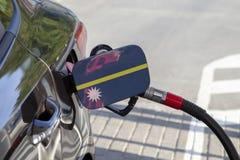 Flag of Nauru on the car`s fuel filler flap. stock photos