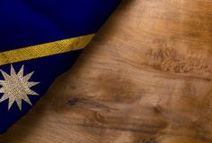 Flag of Nauru. From rough fabric on a wooden surface Stock Photos