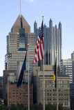 Flag near city. American flag waving near downtown buildings of Pittsburgh Royalty Free Stock Photos