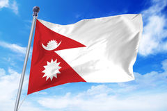 Flag of Nepal developing against a clear blue sky Royalty Free Stock Photography
