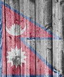 Flag of Nepal on weathered wood Stock Image