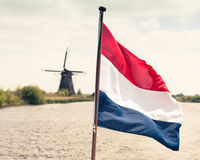 Flag of the Netherlands against windmill background Stock Images