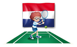 The flag of Netherlands at the back of a tennis player Royalty Free Stock Photography