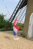 Flags of the Netherlands at a windmill, Beesd, Betuwe, Holland Royalty Free Stock Photos