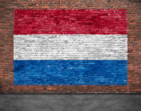 Flag of Netherlands and foreground. Flag of Netherlands painted over old brick wall Stock Images