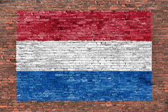 Flag of Netherlands painted over brick wall. Flag of Netherlands painted over aged brick wall Stock Image