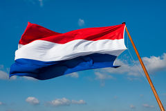 Flag of The Netherlands on pole Stock Photo