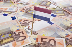 Flag of Netherlands sticking in 50 Euro banknotes.(series) stock image