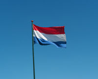Flag of the Netherlands waving in wind, blue sky Royalty Free Stock Photo