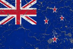 Flag of New Zealand painted on cracked dirty wall. National pattern on vintage style surface stock illustration