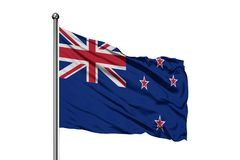 Flag of New Zealand waving in the wind, isolated white background royalty free stock image