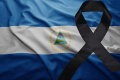 Flag of nicaragua with black mourning ribbon Stock Image